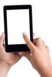 Manos que sostienen la PC de la tableta conmovedora Fotos de archivo libres de regalías