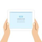 Manos que sostienen la tableta Imagen de archivo