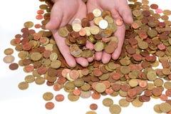 Manos que sostienen monedas euro Imagen de archivo
