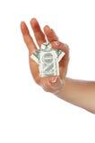 Manos que sostienen un billete de banco en un dólar Fotografía de archivo libre de regalías