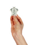 Manos que sostienen un billete de banco en un dólar Fotos de archivo libres de regalías