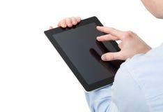 Manos que sostienen un ordenador del tacto de la tableta imagenes de archivo
