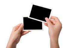 Manos que sostienen una fotografía Imagen de archivo