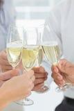 Manos que tuestan con champán Fotografía de archivo libre de regalías