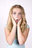 Manos sorprendidas muchacha de la expresión en cara imagen de archivo libre de regalías