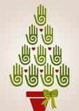 Manos verdes de la diversidad en árbol de navidad Imagen de archivo libre de regalías