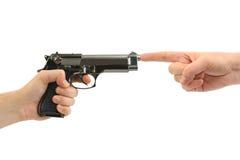 Manos y arma foto de archivo