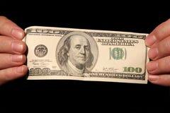 Manos y cientos dólares Imagen de archivo