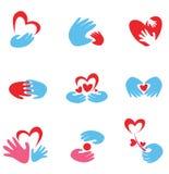 Manos y conjunto del corazón de símbolos Fotos de archivo