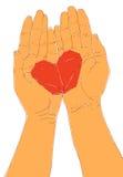 Manos y corazón ahuecados de la papiroflexia Foto de archivo
