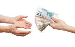 Manos y dinero Foto de archivo libre de regalías