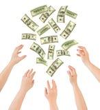 Manos y dinero que cae Imagen de archivo