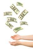 Manos y dinero que cae Imagenes de archivo