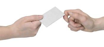 Manos y entrega de la tarjeta del busuness Imagenes de archivo