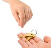Manos y llaves Imagen de archivo libre de regalías