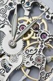 Manos y mecanismo de reloj Imagenes de archivo