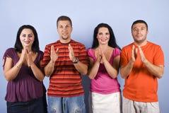 Manos y sonrisa felices del clappingg del grupo Imagen de archivo