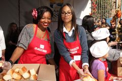 Manouschka Guerrier, Zoe Saldana. At LA Mission Homeless Thanksgiving, Los Angeles Mission, Los Angeles, CA 11-23-11 Royalty Free Stock Images