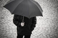 manparaply fotografering för bildbyråer