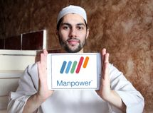 Manpower company logo. Logo of Manpower on samsung tablet holded by arab muslim man. ManpowerGroup is the third-largest staffing firm in the world Stock Images