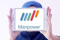 Manpower company logo. Logo of Manpower on samsung tablet holded by arab muslim woman. ManpowerGroup is the third-largest staffing firm in the world Stock Photo