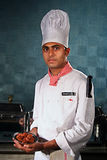 Manpower in hospitality industry. A young man working in hospitality industry in India is showing food at kitchen of a hotel in India.Quality of manpower is Royalty Free Stock Photos