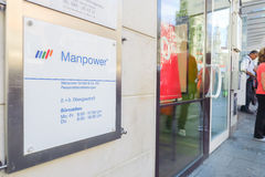 Manpower munich. Sign on the offices of the temp agency Manpower at the Munich Marienplatz with copy space to the right Royalty Free Stock Images