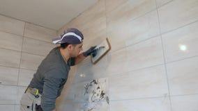 Manputting szwy beż płytki na ścianie zbiory wideo