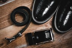 Mans accessories. Shoes with perfume and belt Stock Image