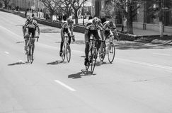 Mans athlete cyclist rides on the road bike Stock Images