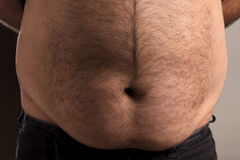 Mans big stomach Royalty Free Stock Images