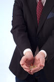 Hands with euro coins. Mans in black suit hands with euro coins Royalty Free Stock Image