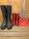 Mans and boys red rubber boots with spades Stock Image