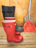 Mans and boys red rubber boots with spades Royalty Free Stock Image
