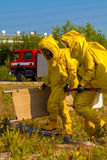 Mans with briefcase in protective hazmat suit. Transport Royalty Free Stock Photo