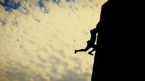 Mans effort. Man climbing a fort stock photos