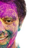 Mans face covered with powder paint during Holi festival Royalty Free Stock Image