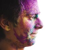 Mans face covered with powder paint during Holi festival Stock Images