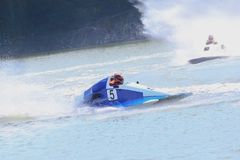 Mans fast floats at power boat on river. At competitions at autumn royalty free stock photo