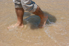 Mans feet in the sea Royalty Free Stock Image