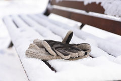 Mans gloves on the winter bench Stock Photography