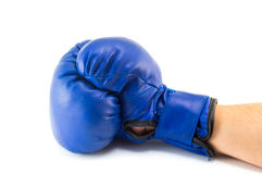 Mans hand in blue boxing glove isolated Stock Photography