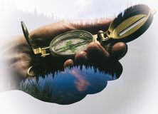 Mans hand with a compass. Stock Photos