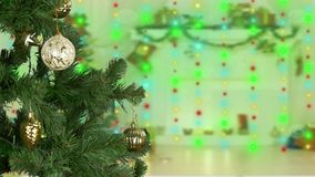 Mans hand decorate christmas tree. Golden lights background. Yellow sphere ball circle. Sparkle glow shine flickering stock footage