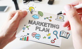 Mans hand drawing Marketing Plan concept on notebook. Mans hand drawing Marketing Plan concept on white notebook stock images