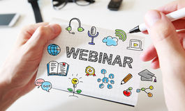 Mans hand drawing Webinar concept on notebook Royalty Free Stock Image