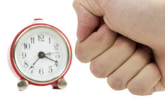 Mans hand in a fist about to hit a red clock Stock Photography