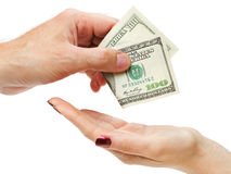 Mans hand giving hundred dollars to womans hand Royalty Free Stock Photography
