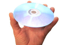 Mans hand holding compact disc on the finger isolated Royalty Free Stock Image