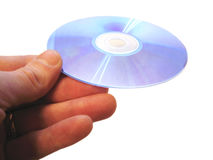 Mans hand holding compact disc on the finger isolated Royalty Free Stock Photography